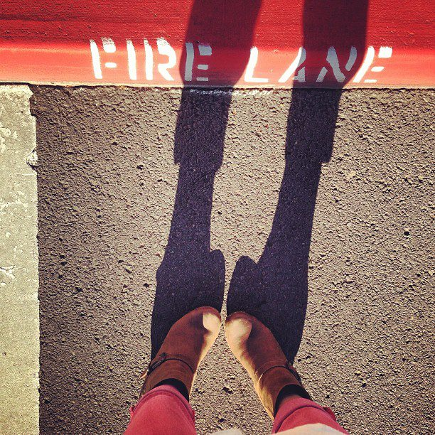 Standing in the fire lane.