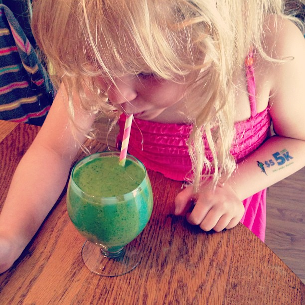 My daughter drinking a green summer smoothie.